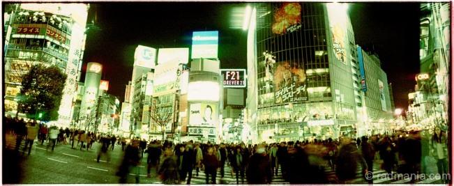 Shibuya Crossing shot with a Russian-made Horizon Perfekt swing-lens pano-camera, on cross-processed 35mm Fuji Provia 400 film.
